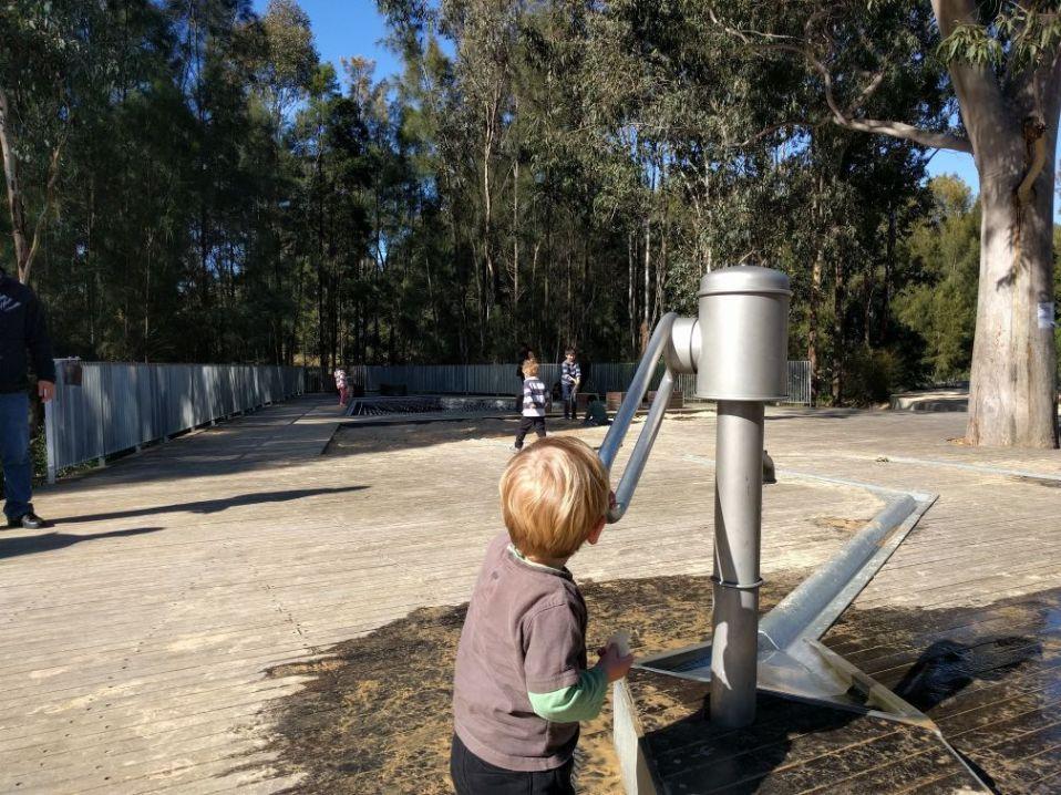 Domain Creek Playground: water pump