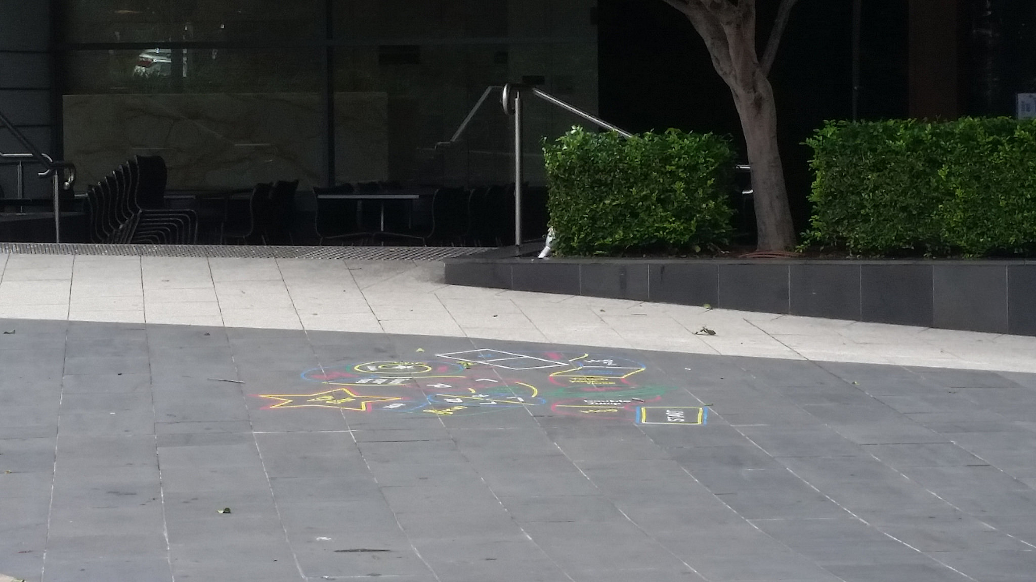 Painted floor for fun and games in the Piazza just outside Hurricanes grill